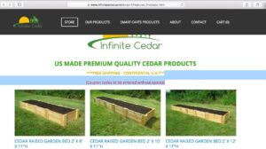Front page of website of Infinite Cedar showing several raised garden beds products set on green lawn and filled with soil