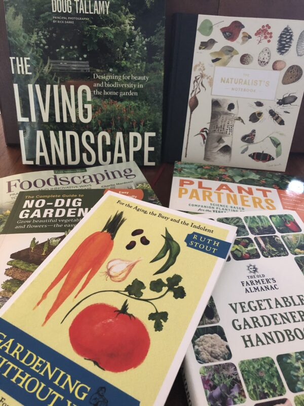 Covers of several books on no-dig gardening, foodscaping, vegetable gardening, and a naturalist's notebook