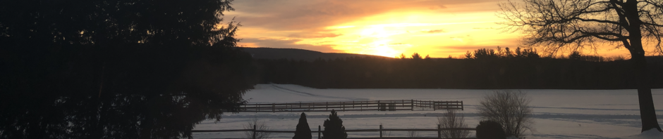 Sunrise over snowy February landscape